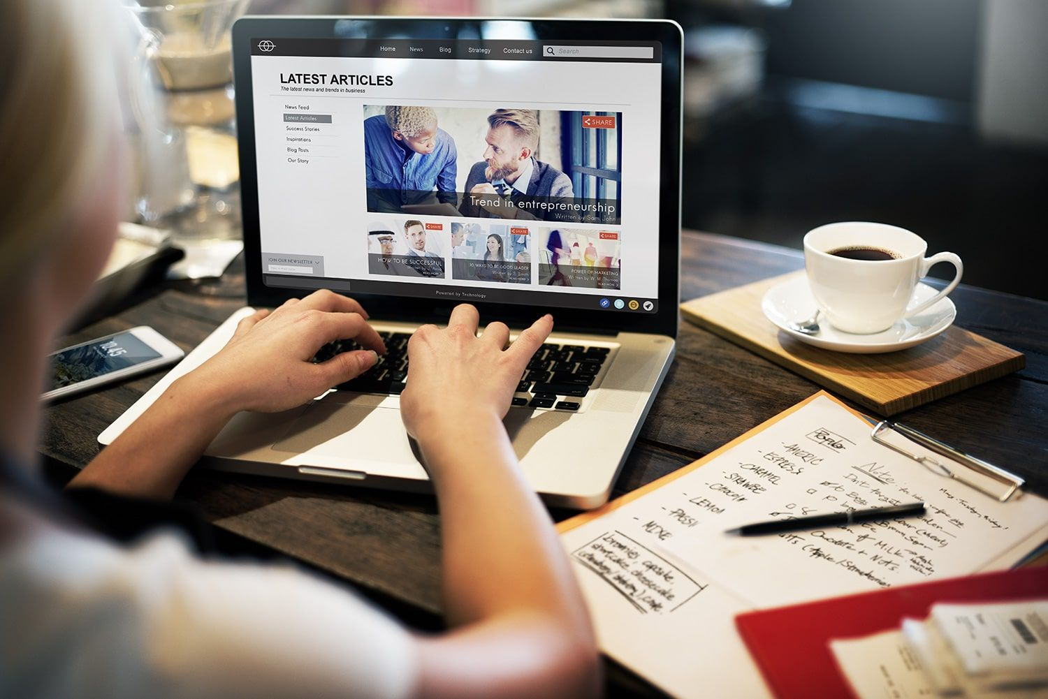 woman searching business trends on laptop
