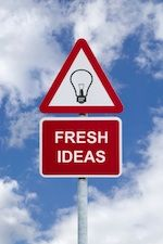 Signpost for 'Fresh Ideas' against a blue cloudy sky