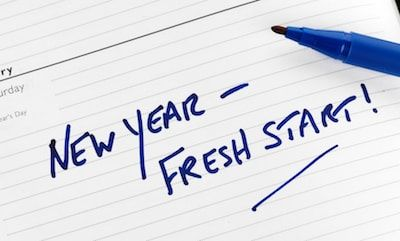 """New year, fresh start!"" text in blue marker ink on planner calendar"