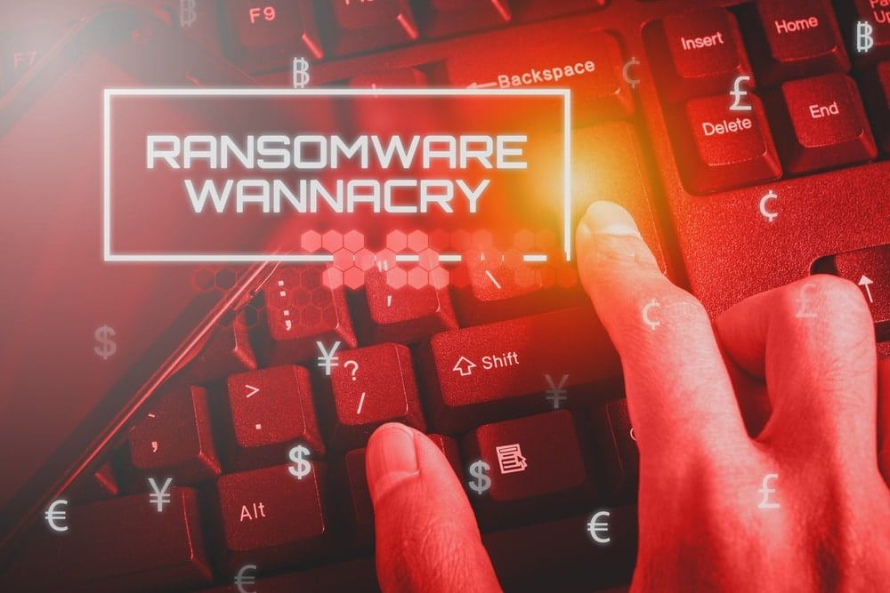 "red background with keyboard and text reading ""Ransomware Wannacry"""