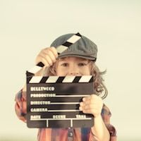 child dressed as director