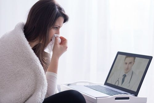 sick patient on video chat with doctor