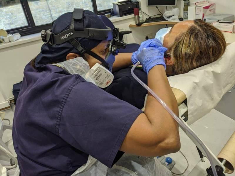 geeta patel performing ear wax removal procedure ppe