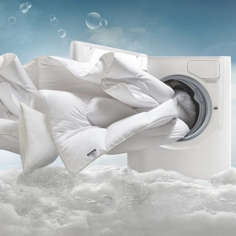 Giặt chăn ga giường để loại bỏ mùi hôi