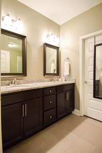Fantastic master bath, granite double vanities, door to huge walk-in closet