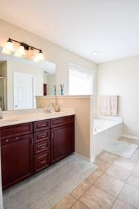 Terrific full bath, double vanities