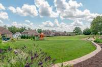 Huge backyard with fantastic playset staying with the house!