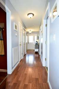 View of the hallway from full bath
