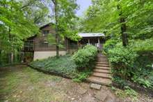 Charm abounds in this rustic log cabin in Watertown, TN.
