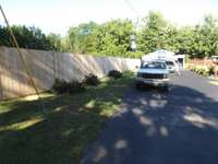 Privacy fence across the back of property. 1 half acre lot