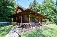 Absolutely lovely log cabin with wrap covered deck