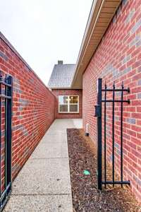 Approaching your private courtyard patio. Photo is NOT of actual home and finishes will vary.