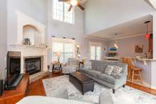Open living room with soaring ceiling.  Very spacious