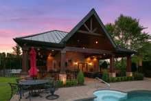 Outdoor entertaining is elevated with this amazing Pool House with kitchen, full bath and outdoor shower. Also included is amazing grilling, bar and outdoor seating for watching movies on summer evenings