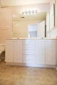 Double vanities in owner's suite bath