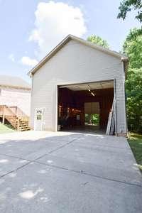 Massive 40x28 detached garage/workshop/RV storage. 13' door
