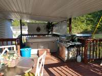 COVERED DECK WITH HOT TUB