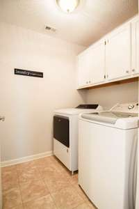 Nice utility room on the upper level