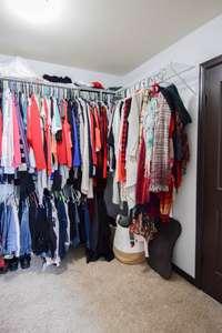 Large walk-in closet and door to walk-in storage