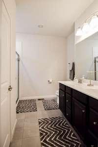 Lovely full bath, double vanities
