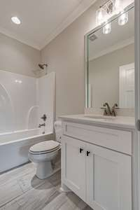 **Example of similar home built by Tim Tomlinson Homes. Color, textures, accents, etc may differ.