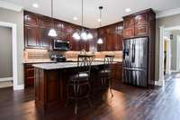 Gorgeous Walnut -stained custom cabinets