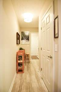 Hallway to pantry, utility room, and garage
