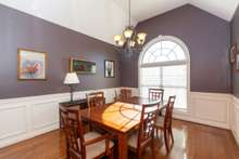 15x11 Dining room with Wainscoting, hardwood floors and double arc window
