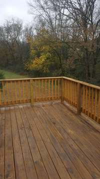 New deck with private backyard perfect for entertaining or enjoying a cup of coffee