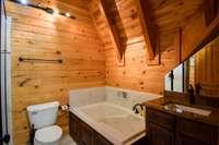 Very lovely upper full bath, huge jetted tub, nice shower, separate double vanities