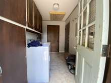 Back entrance with laundry room for B side