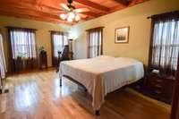 Grand master bedroom room, 4 large windows, double window door to rear deck