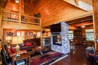 Outstanding double-sided fireplace, living room, and dining room