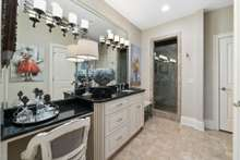 This shared bathroom does not disappoint with tile shower and expanded vanity and a large linen closet to keep everything tidy