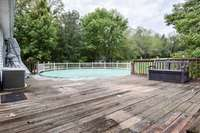Very large rear deck and nice swimming pool, very private
