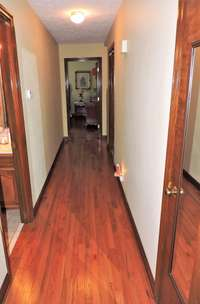 The home has hardwood floors with hardwood trim, in very good condition.