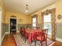 """Another view of the formal dining room area """"dressed up"""". This photo is a few years old."""
