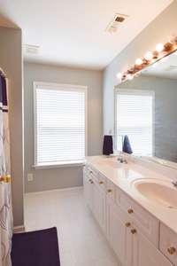 Upper level full bath, double vanities, shower/tub combo