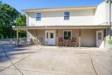 Covered patio area with separate entrance for basement level living to suit the needs multi generational living