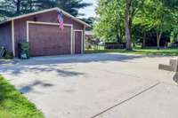 Large detached garage and large parking area in rear
