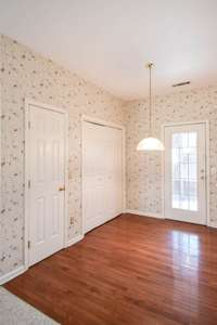 Dining area, pantry, laundry area, and door to rear