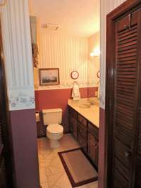 On suite bathroom with tub/shower combo.  Closets on both sides.