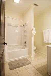 Lovely crisp white full bath, shower/tub combo