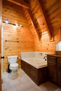 Lovely full bath on upper level, separate shower and tub