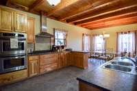Beautiful walnut cabinets in spacious kitchen