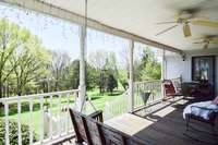 Grand covered front porch with fantastic views