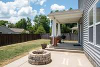 Plenty of room to entertain under the covered porch or around the fire pit.