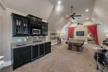 Pool anyone? Wet bar with UC refrigerator and ice maker along with microwave ensures no need to return to the kitchen