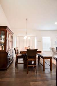 Charming dining area, door to fenced rear