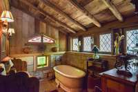 Wonderful antique stained glass in full bath